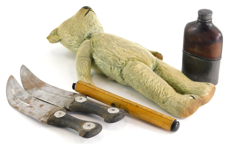 An early 20thC plush teddy bear, a Mauchline ware ruler, two daggers and a pewter and leather hipfla