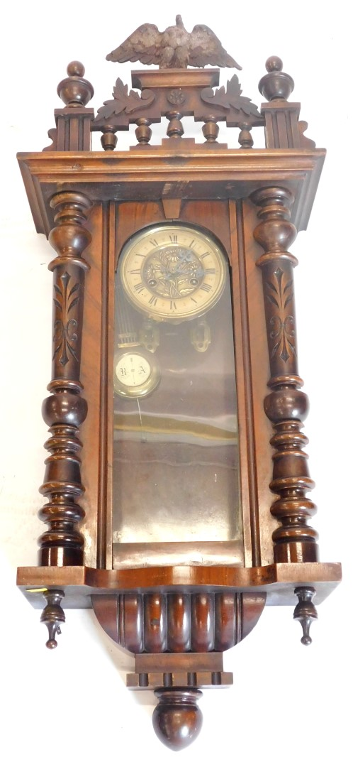A late 19thC/early 20thC Vienna type wall clock, in wall case with paper dial, Art Nouveau press bra