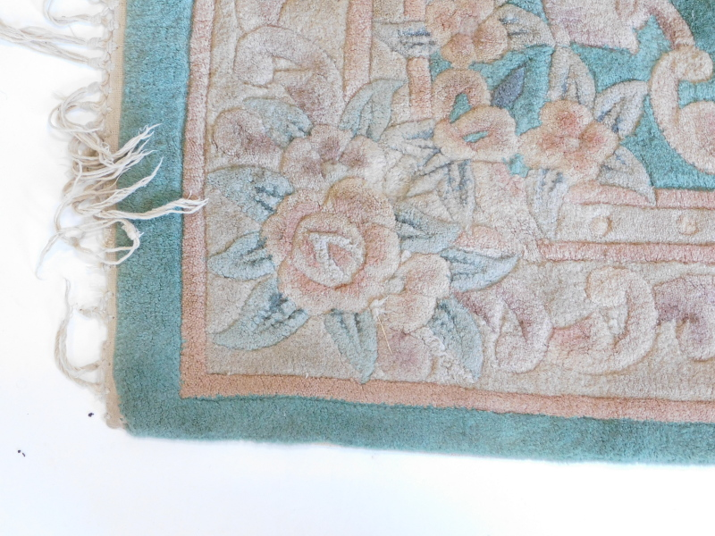 A Chinese rug, with a green ground, decorated in Aubusson style, 180cm x 120cm. - Image 2 of 3