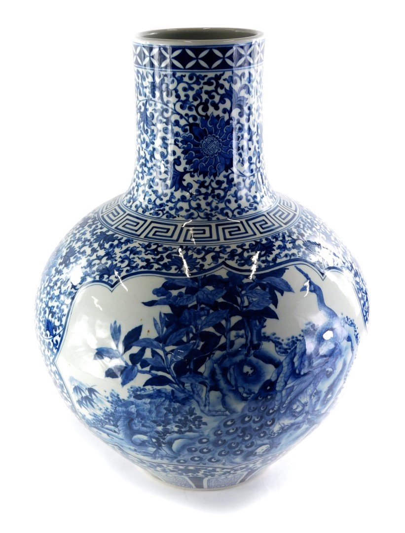 A late Chinese blue and white porcelain bottle shaped vase, decorated with birds, butterflies, flowe