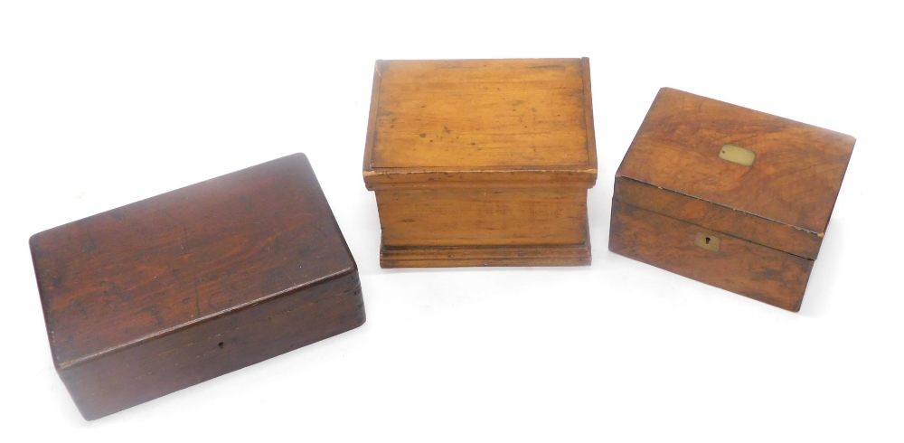 Three wooden boxes, to include a figured walnut box, with vacant cartouche.