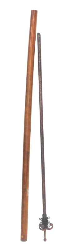 A turned hardwood curtain pole with rings, 250cm long, and a red painted metal curtain pole, 132cm l
