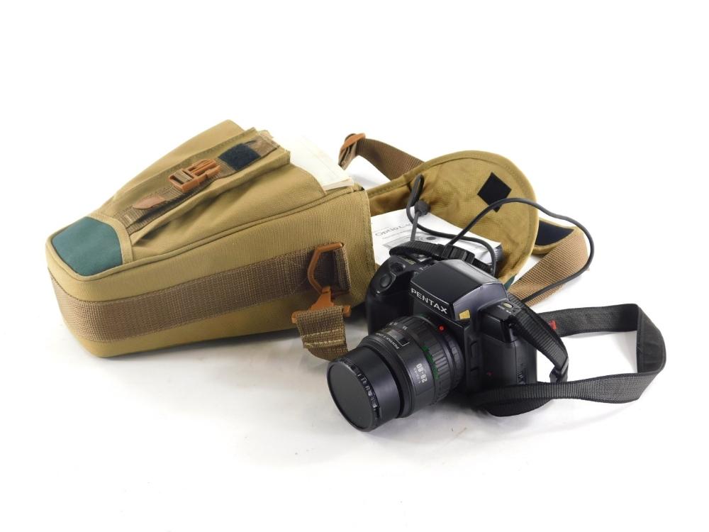 A Pentax SF7 camera with lens, etc.