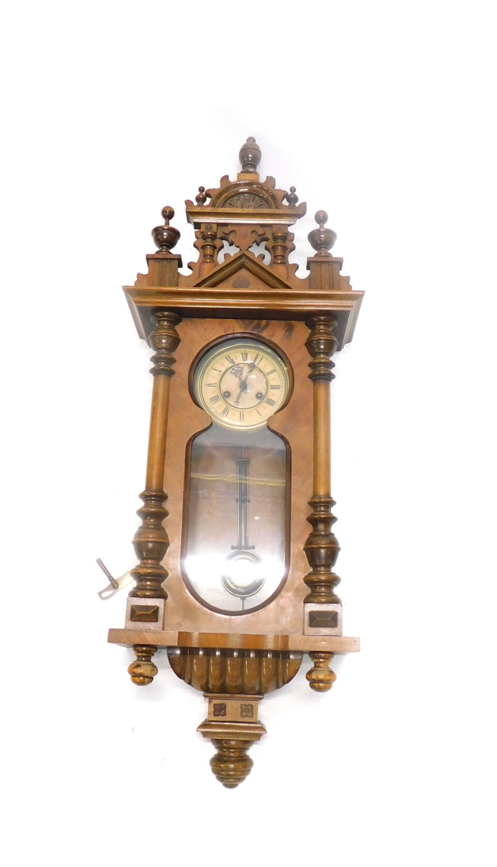 A Vienna type walnut wall clock, with part paper dial, 100cm overall.