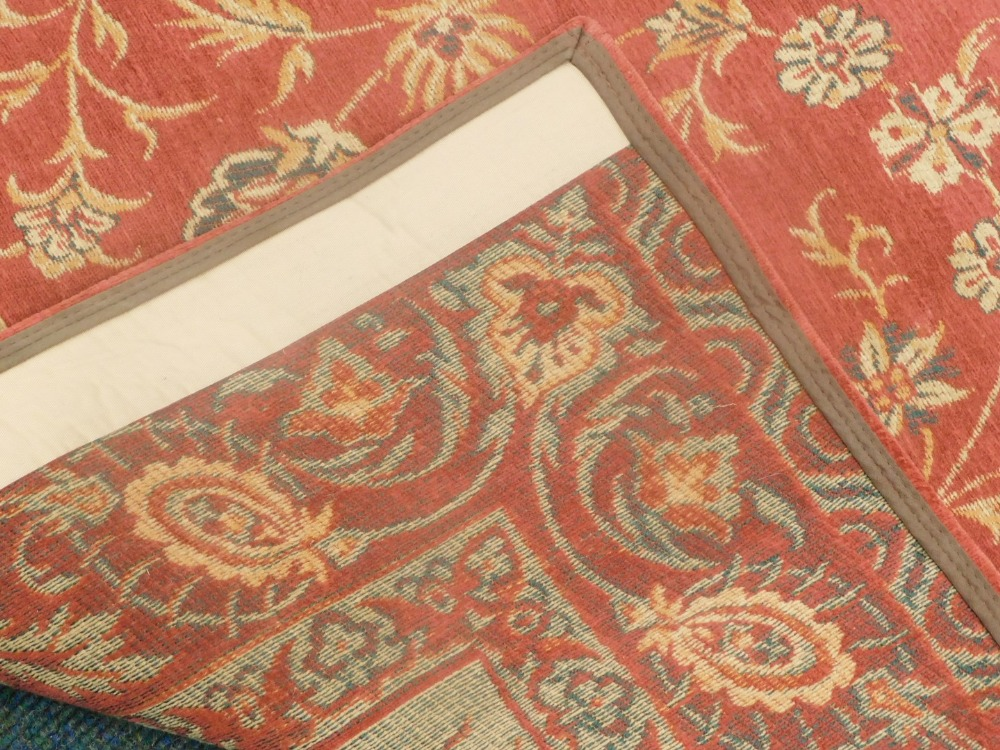 A Laura Ashley Belgian cotton rug, on a red ground. - Image 3 of 3