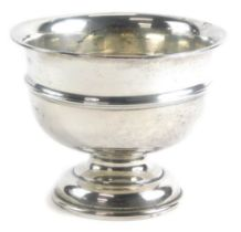 An Edward VII silver pedestal bowl, of plain form with a central raised rim, Chester 1908, 12cm high