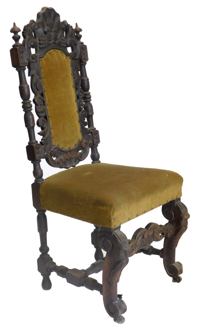 A Victorian ebonised oak side chair, with a padded back and seat on scroll carved legs. (AF)