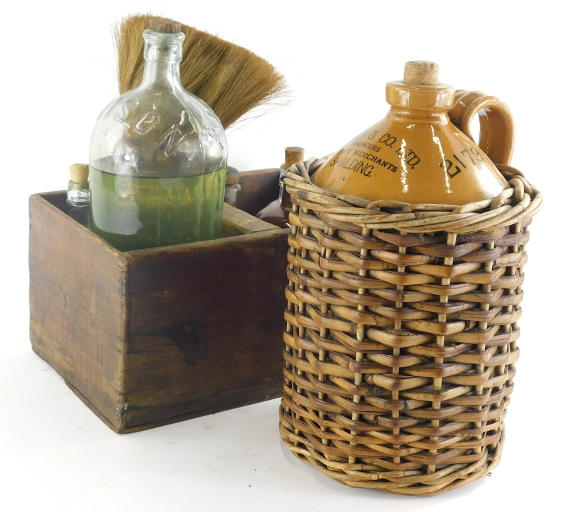 An early 20thC Soames and Co of Spalding stoneware two coloured flagon, in wicker casing, 41cm high,