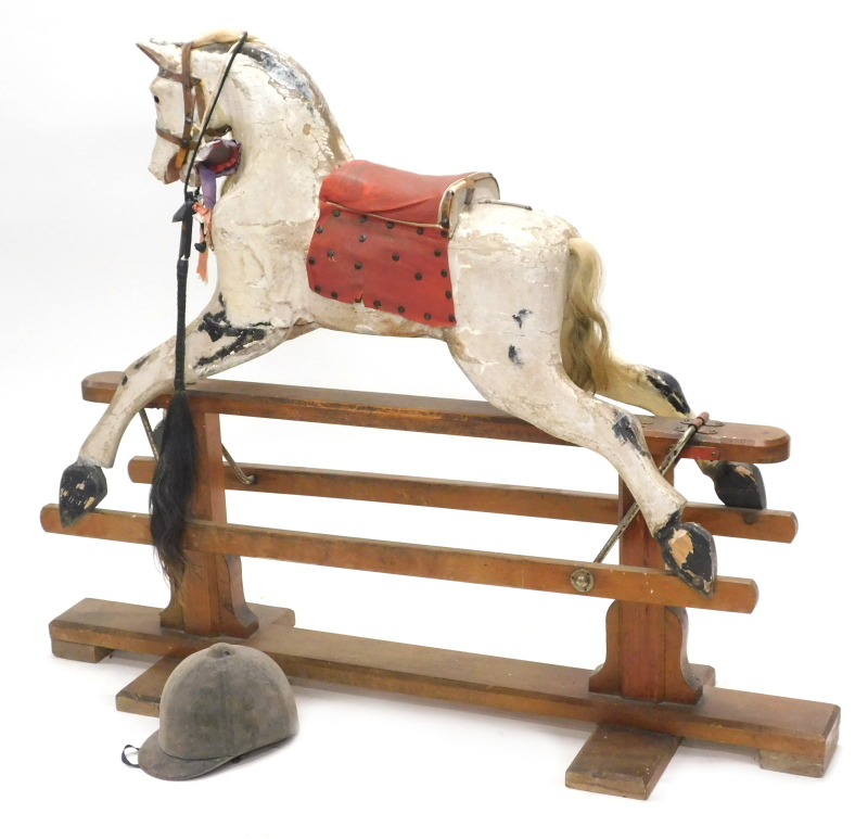 A Victorian dapple grey rocking horse, the pitch pine trestle stand with indistinct label, (AF), 120