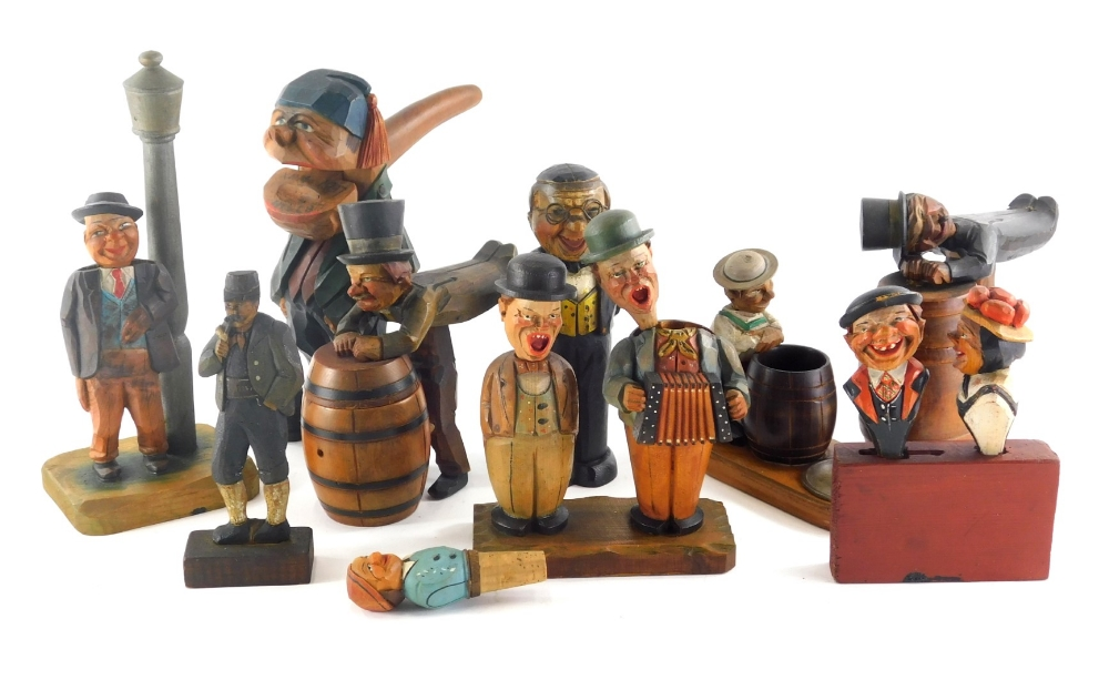 A good and varied selection of continental carved articulated figures, to include cork screws, shoe