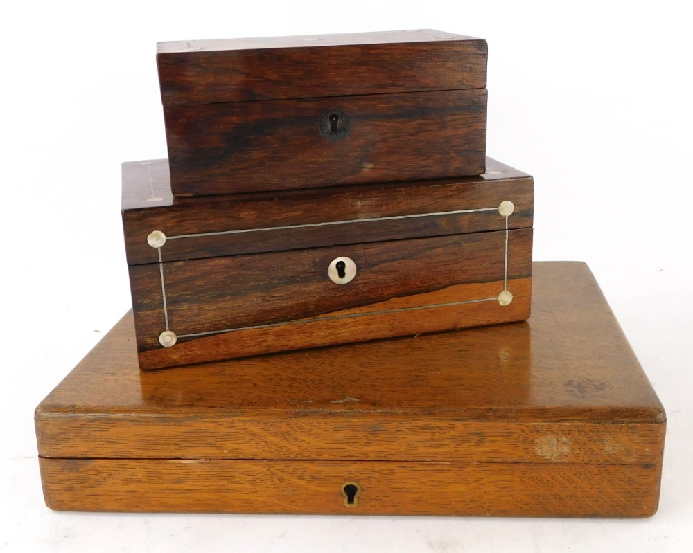 A collection of boxes, to include two rosewood and mother of pearl inlaid jewellery boxes and an oak