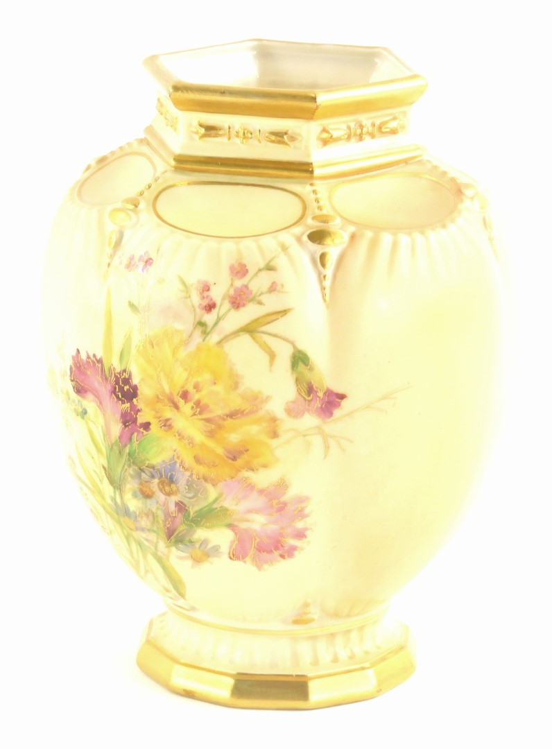 A Royal Worcester porcelain pot pourri jar, painted with flowers and leaves on a blush ivory ground,