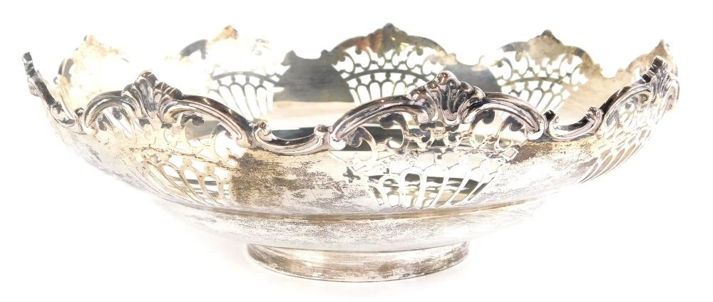 A George V silver dish, of flared form, partially pierced, on circular foot, Sheffield 1920, 23cm wi