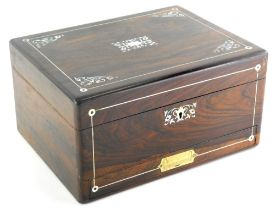 A rosewood and mother of pearl inlaid box, of rectangular form, the hinged lid revealing a leather s