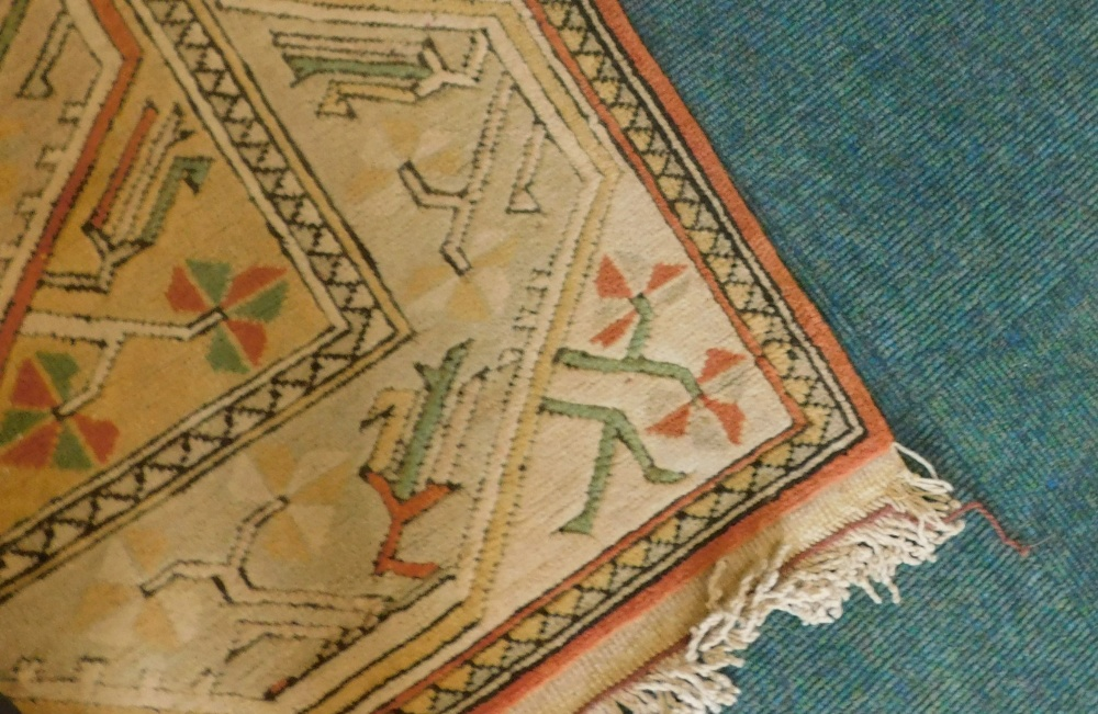 A Turkish rug, with a multi coloured geometric design, on a cream ground with multiple borders, 216c - Image 2 of 3