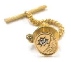 A collar stud, set with tiny illusion set diamond, in a 9ct gold, oval plate, in a gold plated pin b