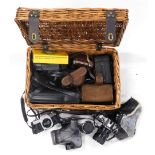 A collection of cameras, to include two Canon camera AE1, Canon lenses, Kodak and other cameras, etc