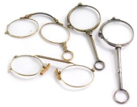 A small collection of lorgnette, to include three examples, each with gold coloured metal frames and