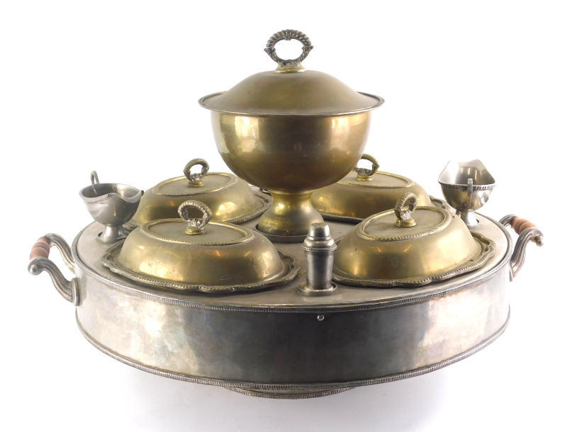 A 20thC silver plated hot plate stand, of circular form, centred by a removable bowl, with four entr