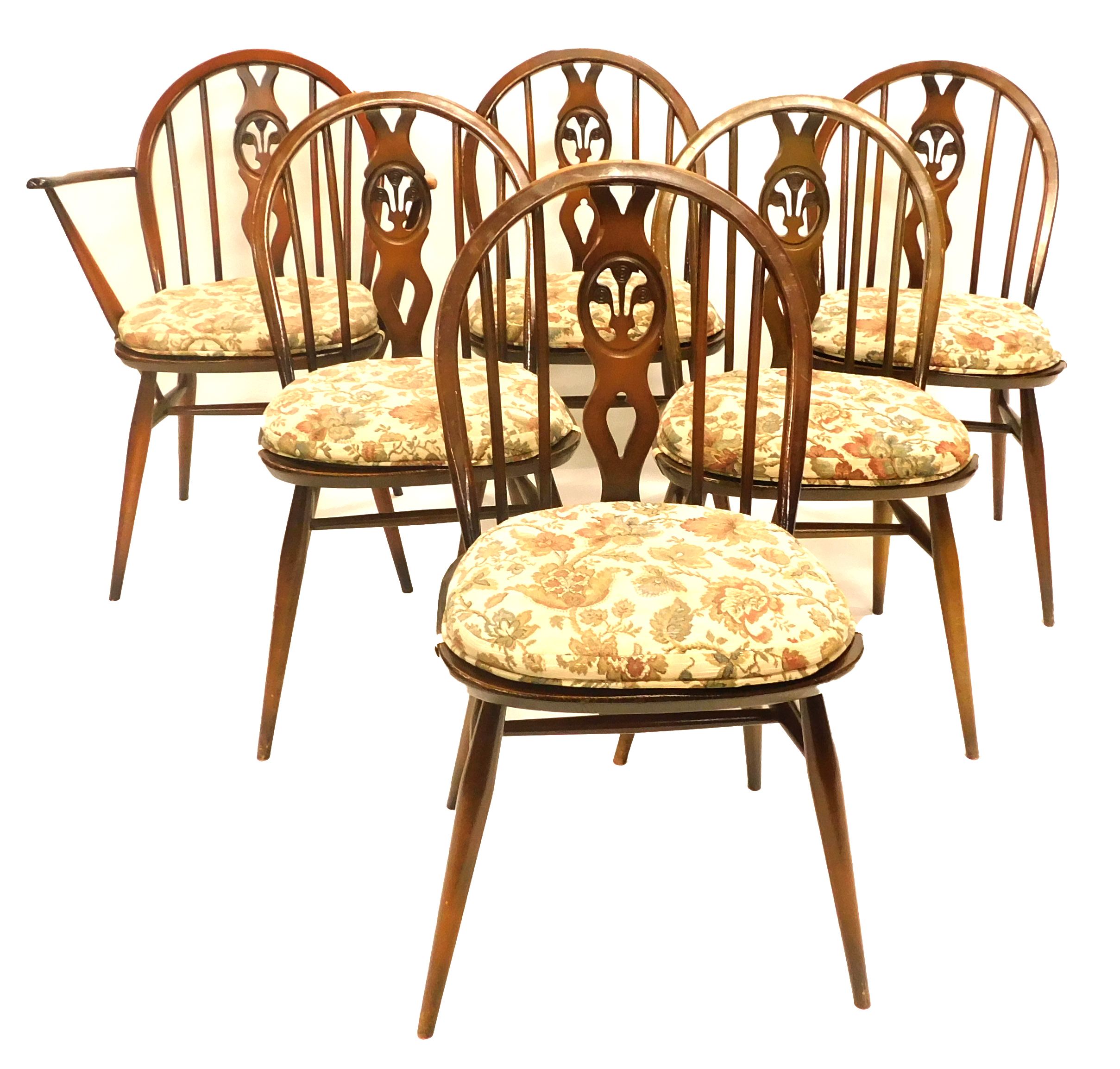 A set of six Ercol beech and elm Windsor chairs, each with a pierced splat, a solid seat on turned l