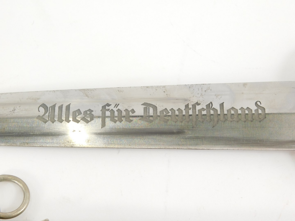 A Third Reich SA dagger, with emblem and eagle mounts to wooden handle, the blade stamped Alles Fur - Image 2 of 4