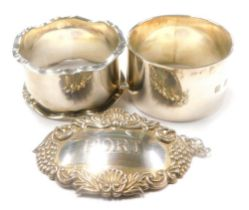 A collection of small silver, Port decanter label and two napkin rings, 2¼oz overall. (3)