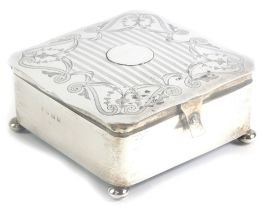 A George V silver jewellery or trinket box, of square form, the top with a shaped edge and a circula