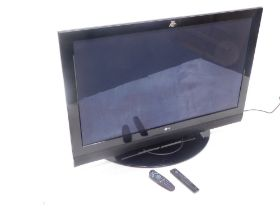 An LG 50 inch LCD television model no. 50PC56, with associated remote, etc. (AF)