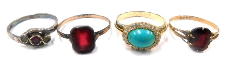 Four various dress rings, each with coloured stones, most mounts unmarked.