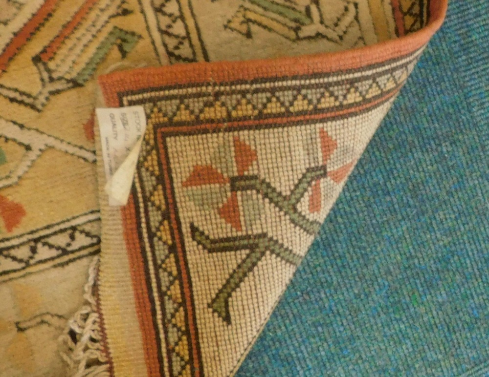 A Turkish rug, with a multi coloured geometric design, on a cream ground with multiple borders, 216c - Image 3 of 3
