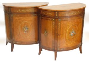 WITHDRAWN PRE SALE BY VENDOR. A pair of satinwood demi lune side cabinets, in Sheraton revival