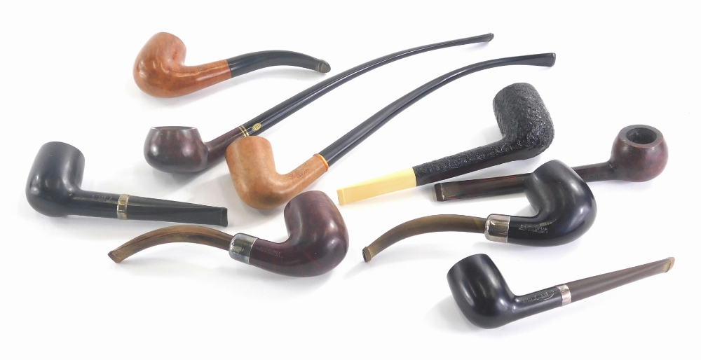 A quantity of turned and burr wood and briar pipes, names to include Plumb, Dress, Dunhill, etc.