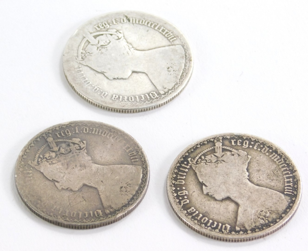 A small collection of coins, to include Victorian 1877 Gothic florin, 1876 Gothic florin and an 1877