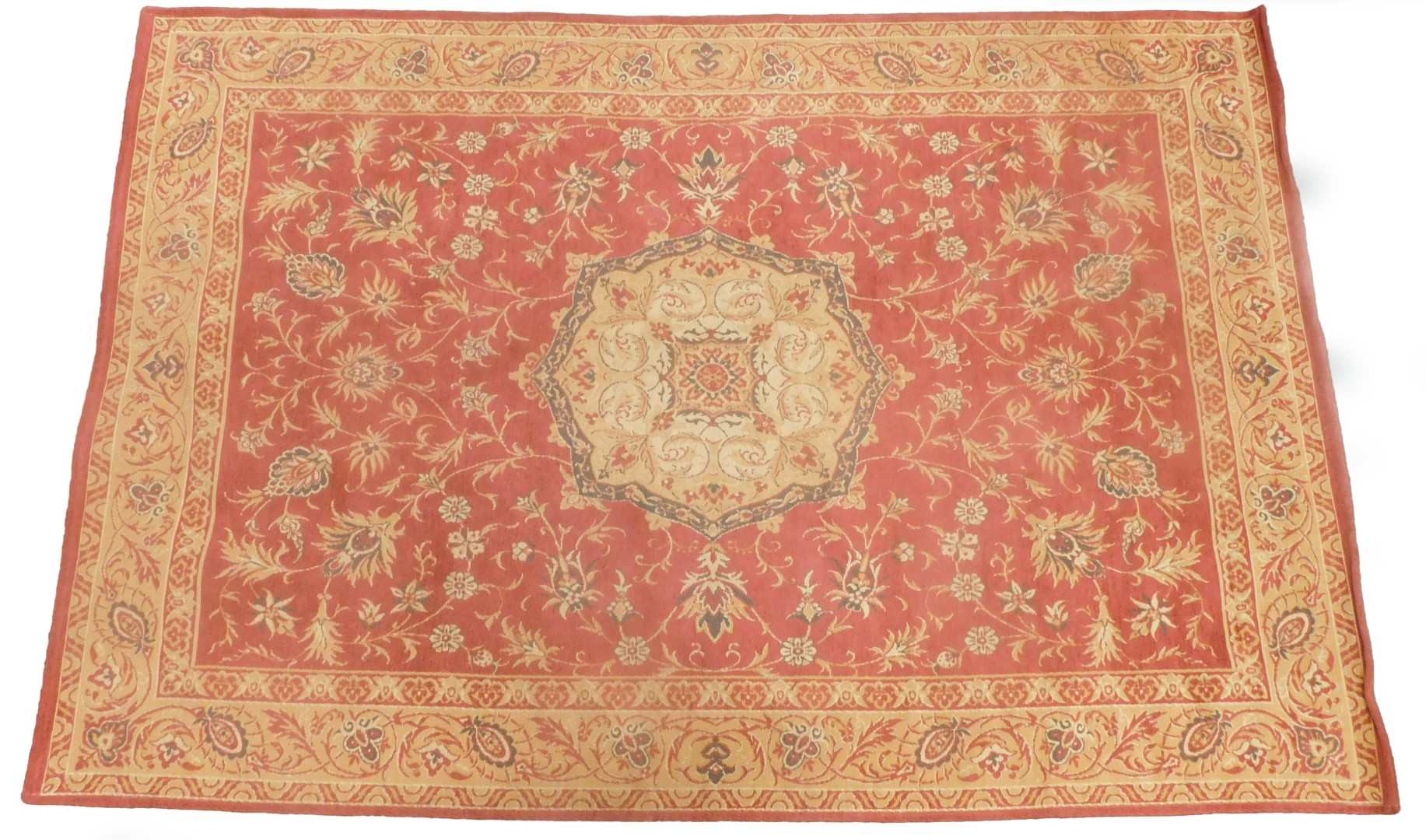 A Laura Ashley Belgian cotton rug, on a red ground.