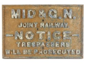 A Midland and Great Northern cast iron railway sign, Joint Railway Notice Trespasses will be Prosecu