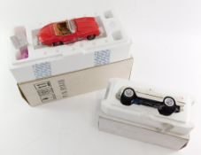A Franklin Mint die cast model of a 1960 Mercedes Benz 300SL Roadster, together with a 1953 Corvette