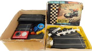 A Scalextric model motor racing set, lacking cars, boxed, together with First Scalextric. (a quantit