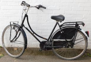 A Holland Classic President lady's bicycle, retro style with black frame, basket to the front.
