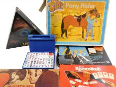 Games and toys, including Action Girl pony rider, Zone X, UBI, and Mahjong. (6)