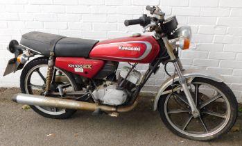 A Kawasaki KH100EX motorcycle, registration NRC73W, mileage on clock 471.2miles.
