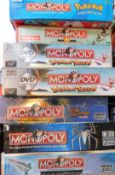Seven themed Monopoly sets, comprising Pokemon., Coronation Street., Tropical Tycoon (x2)., Duel M