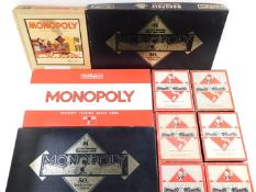 Two Waddingtons Monopoly 50th Anniversary Edition games, a wooden cased Monopoly, board damaged, and