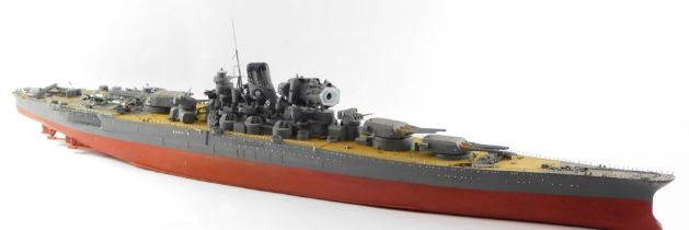 A scale model of a Japanese WWII battle ship, possibly The Yamato, modeled with armourments, deck pl