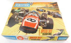 A Scalextric, including cars, track, etc., in a 12E set box.