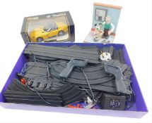 A Burago die cast model of a Dodge Viper, RT/10, scale 1:18, 3065, boxed, together with Scalextric a