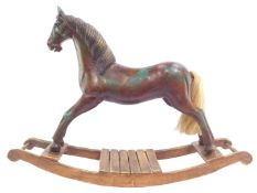 A vintage style carved wooden rocking horse, with horse hair tail, raised on a sleigh type base, 60c
