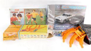 A Hot Wheels loop the loop, air fix football game, and a micro Scalextric James Bond Austin Martin D
