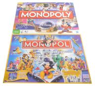 A Monopoly Disney Edition game, together with a further Disney Edition, Utgavan, both boxed. (2)