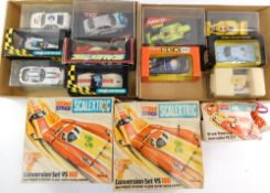 Scalextric motor cars, two conversion sets YS100, controller YS271, etc., all boxed. (a quantity)
