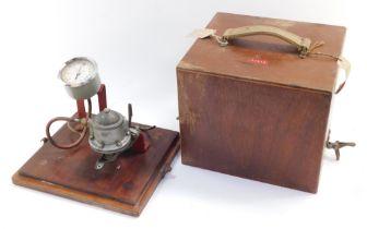 An AC Type U vacuum pump fuel tester, 7/273., cased.